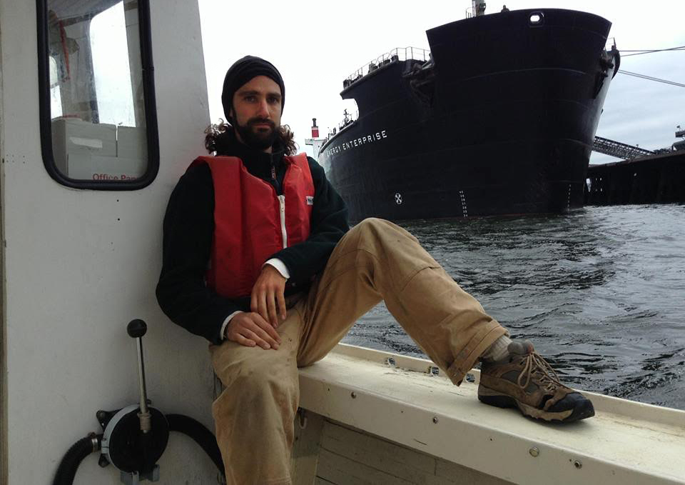 Jay O'Hara next to the Energy Enterprise during Lobster Boat Blockade, via http://www.climatedisobedience.org/