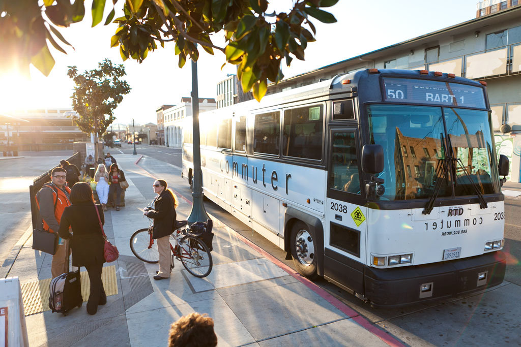 Commuters wait to board a San Joaquin RTD commuter bus. Image credit: San Joaquin RTD (CC BY-NC-ND 2.0)