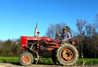 VA.OriginsAlistar_on_tractor.jpg