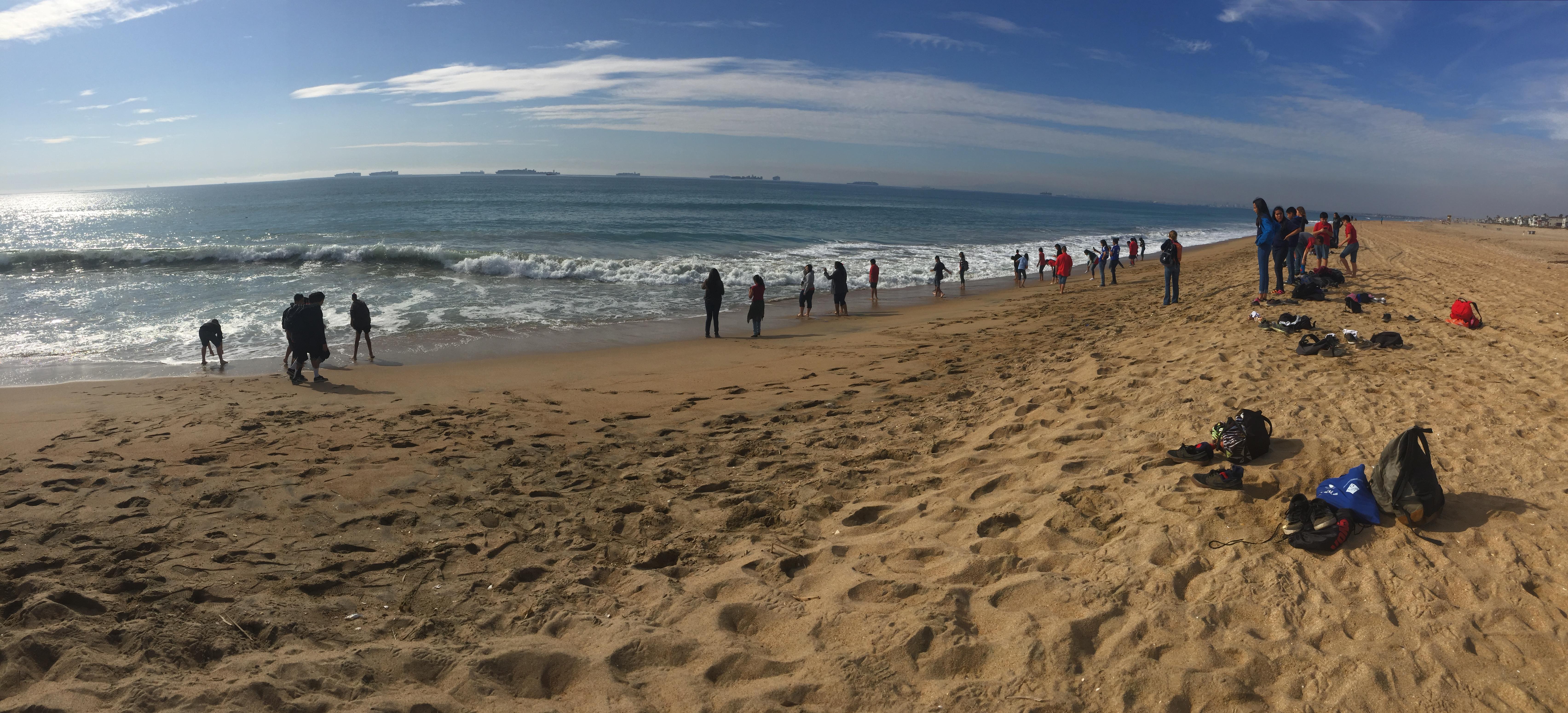 Students enjoying Bolsa Chica State Beach on a field trip
