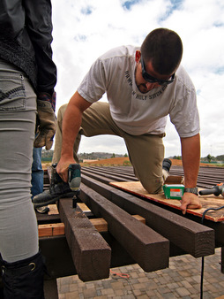 Coastkeeper's Austin Brown works on the top of the trellis