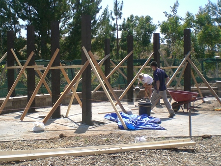 Interns work on the Bungalow trellis