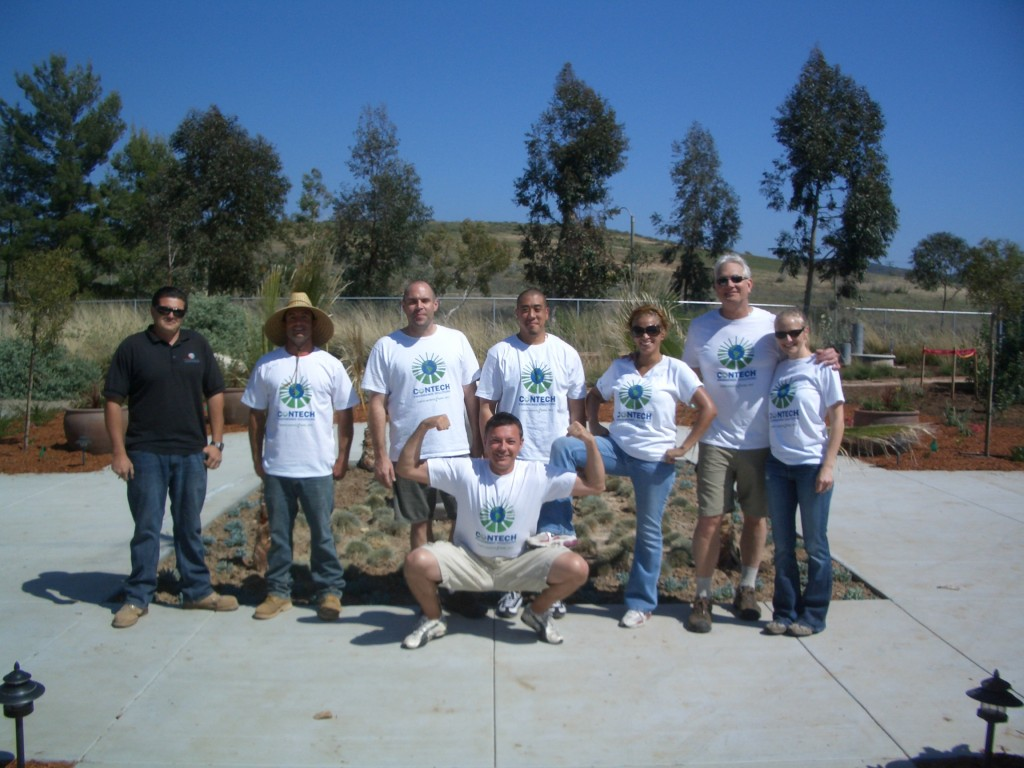 The rest of the Contech group with our garden staff showing off their strength!
