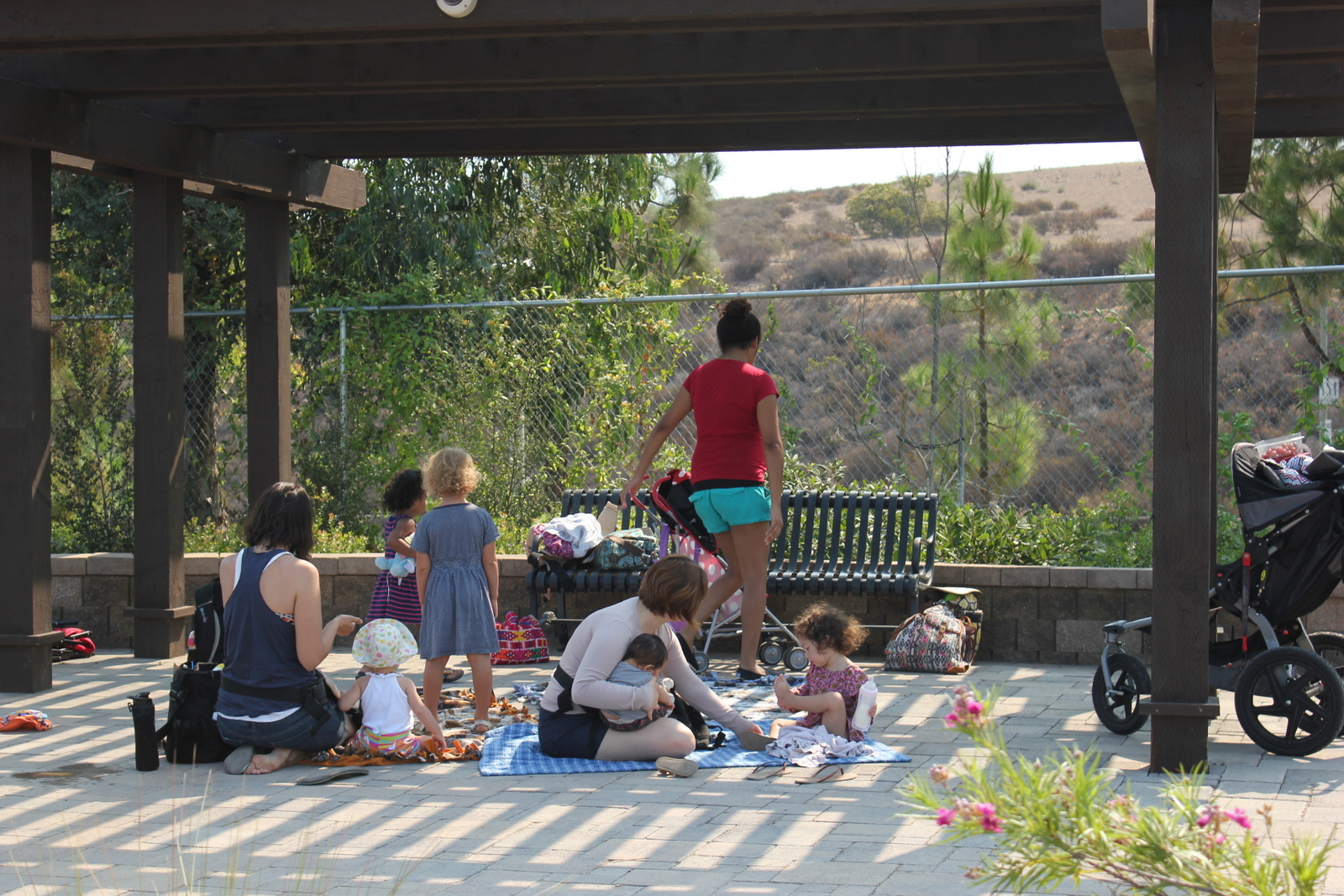 Friends enjoy a shady picnic area at the craftsman bungalow.