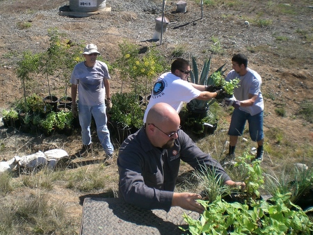 Coastkeeper volunteers help Harvest Landscaping unload plants