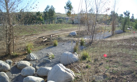 Completed dry creek bed with boulders and gravel