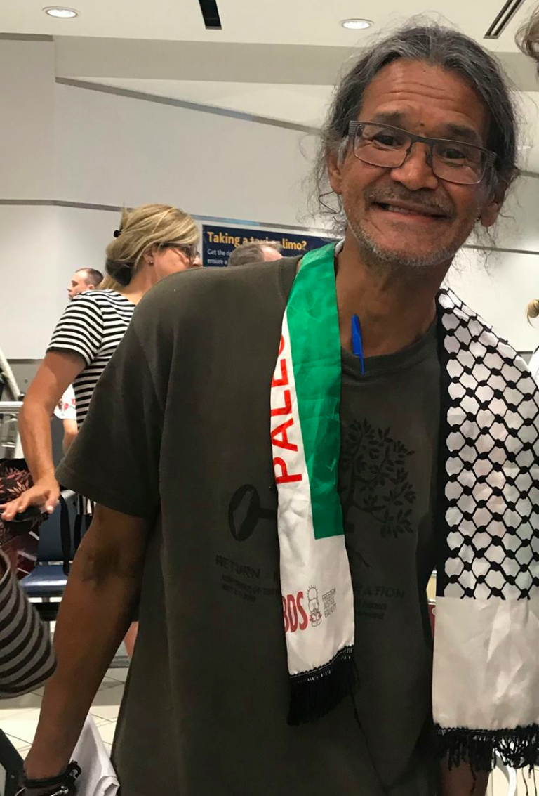 Photo-by-Audrey-Huntley-of-Larry-Commodore-on-his-arrival-at-the-Toronto-airport-after-his-medical-ordeals-while-in-Israeli-prison.-768x1133.png