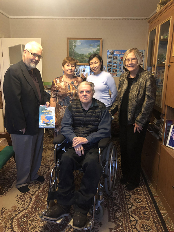 Photo by Ann Wright.  Author in center, Ivan Efimovich Negenblys; Left to right- Rotarian and host Pete Clark, researcher and Ivan's wife Galina; host and Rotarian Katya Allekseeva; Ann Wright