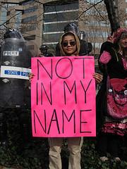 A CODEPINK protester on the Washington Mall in D.C. this March, at the national mass march marking the 6th anniversary of the Iraq War.