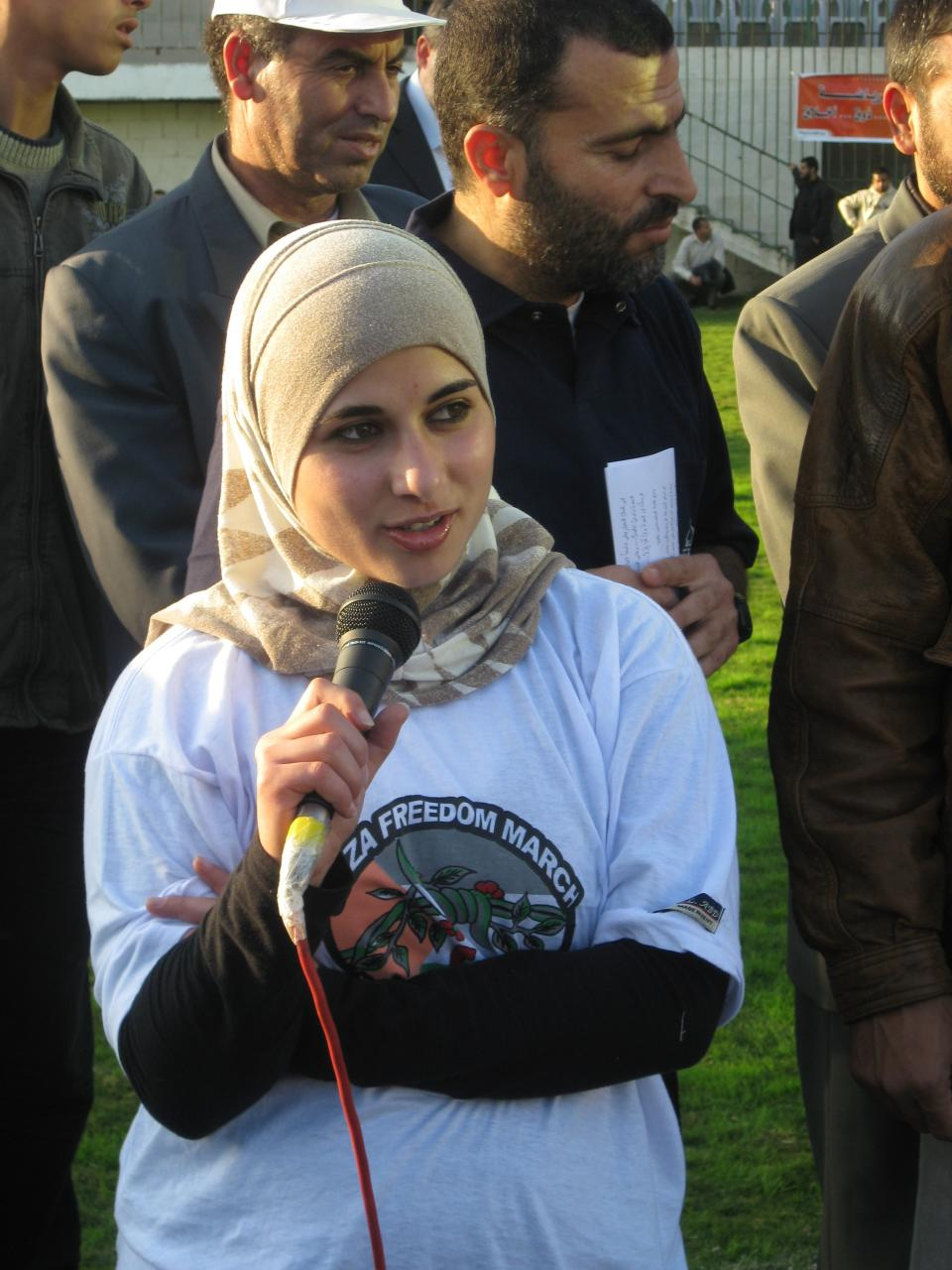 Nuha Masri speaks to the soccer players and officials