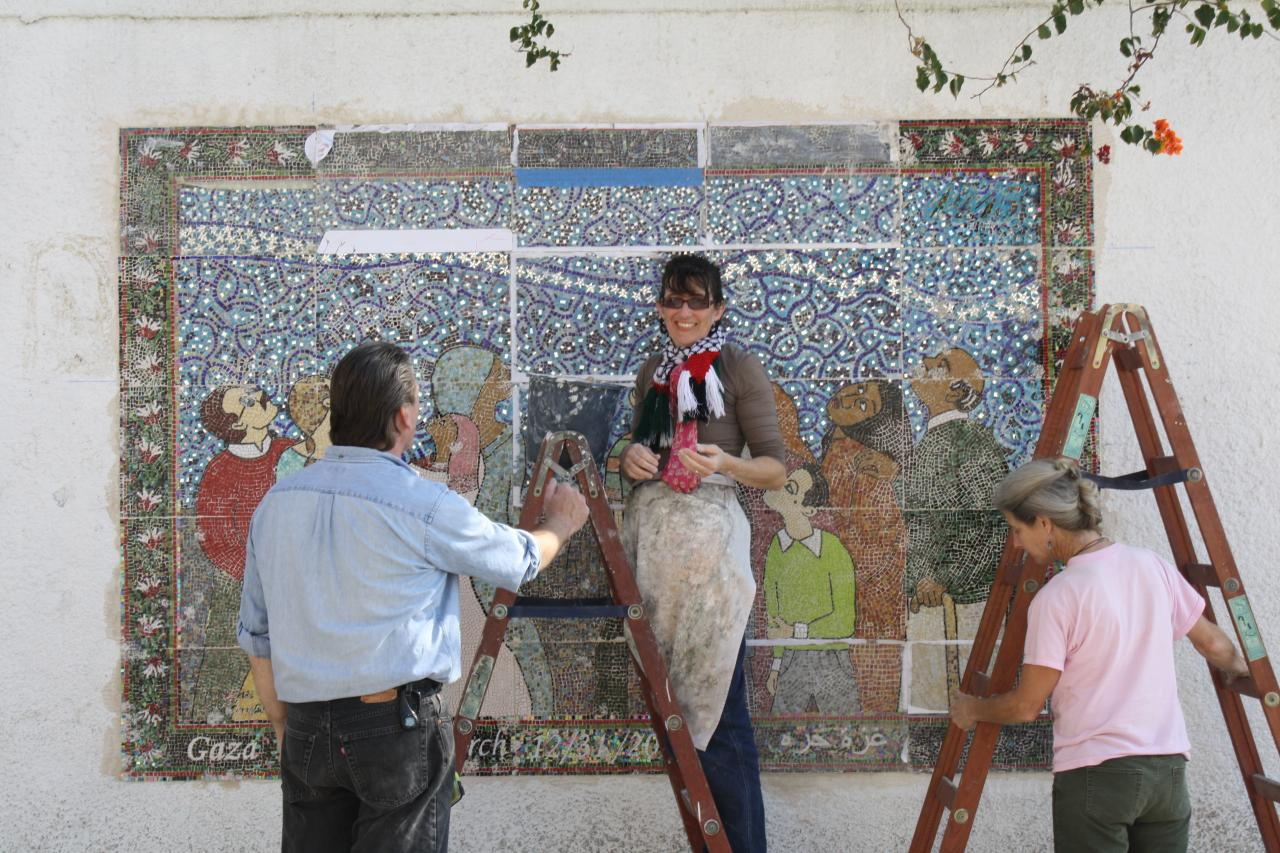 Kathleen and team install the mosaic in Gaza City