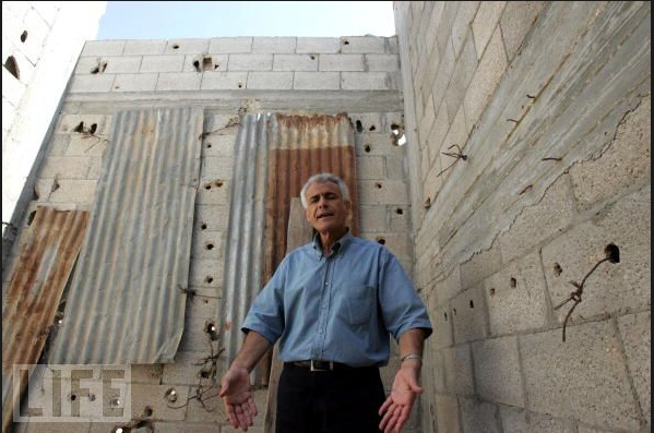 Khalil Bashir in front of his house in Deir Al-Balah in September, 2005
