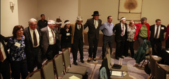 Homeland Security and corporate contractors participate in circle dance to celebrate new energy plan