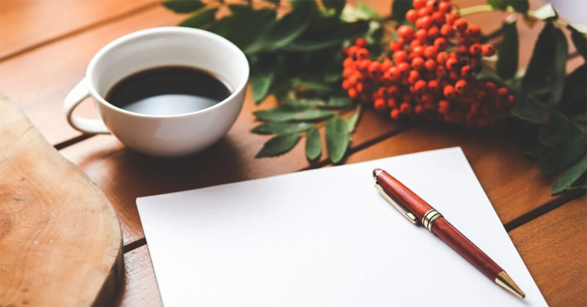 Contact Us - Photo of pen, paper, and cup of coffee. Coffee Party USA