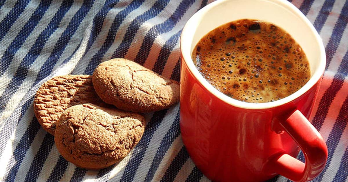 Privacy and Cookies (photo of red cup of coffee with cookies on a white and blue striped table cloth) - Coffee Party USA.