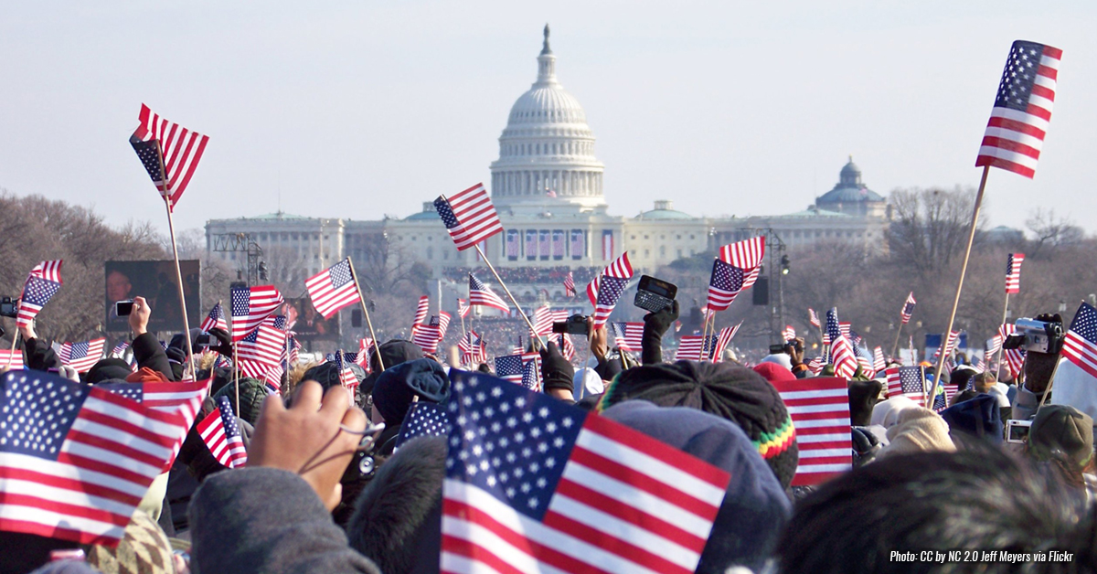 Get Involved - Photo of crowd waving flags on Capitol Hill in Washington DC>