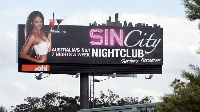 sin_city_billboard_woman_drinks_white_top.jpg