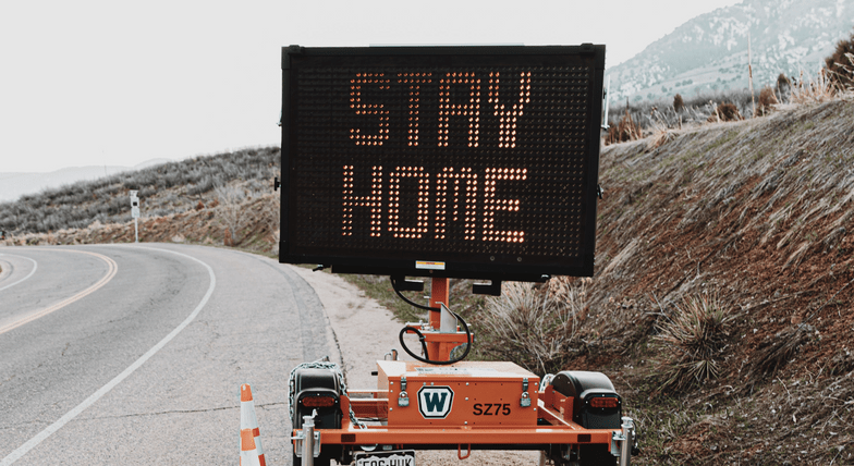 Road sign that says 'Stay home'.