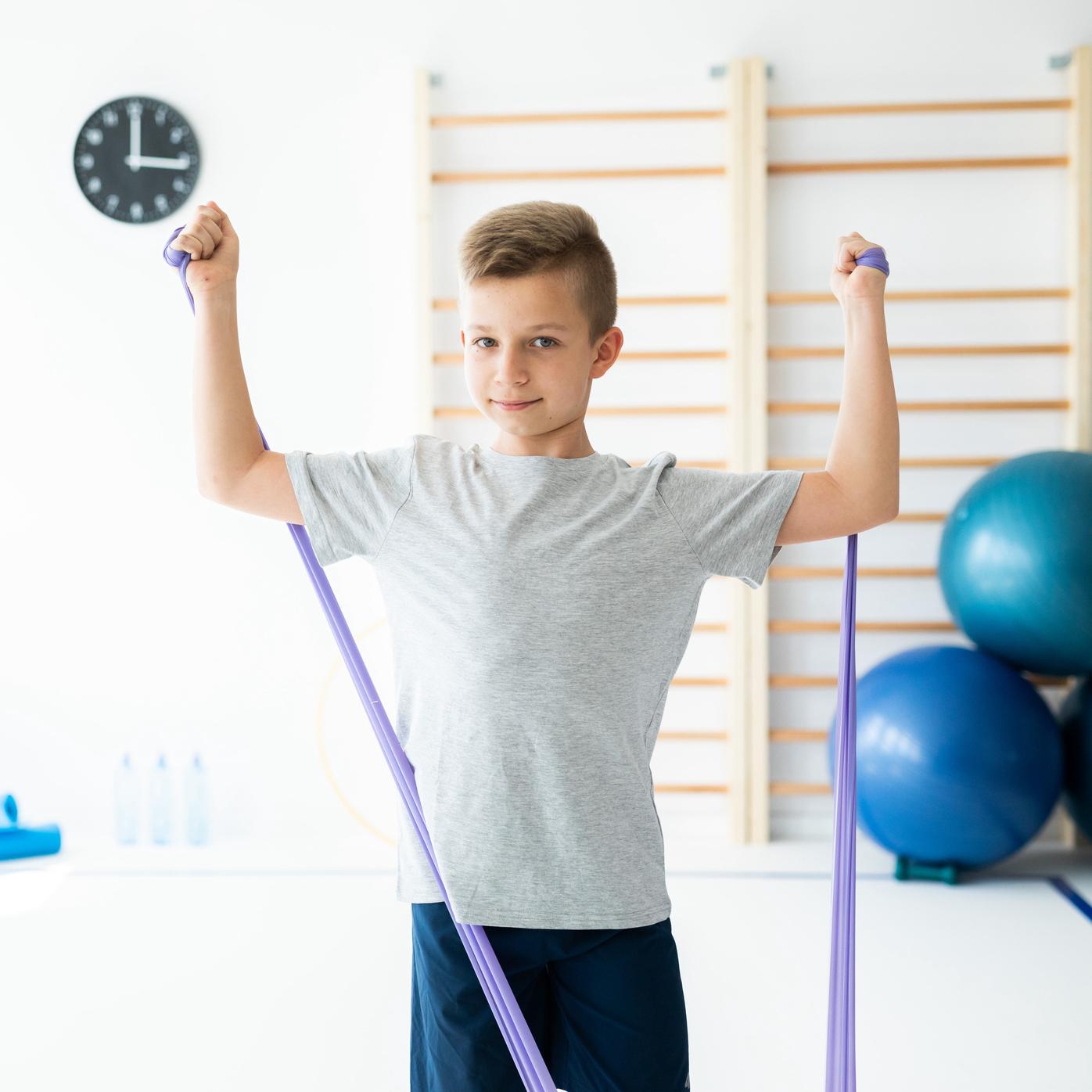 boy using exercise bands