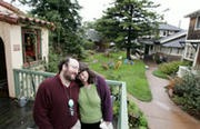 Cohousing Coaches Betsy Morris and Raines Cohen on the lawn at Berkeley Cohousing