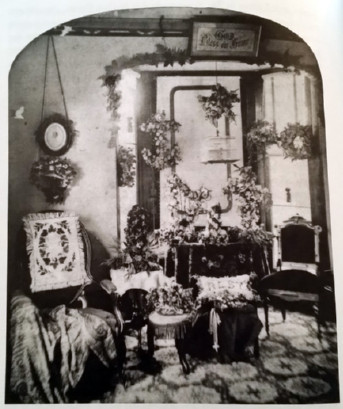 image of parlor filled wtih flowers, needlework, etc.