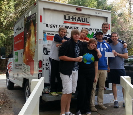 members ready to move (in front of a U-Haul truck)