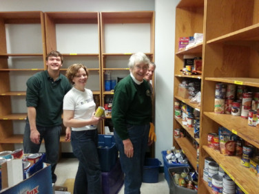 members working during a service project at a food pantry