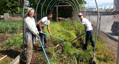 Congregation members working in garden at service project at SEEDS