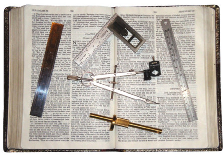 photo of rulers, dividers, and other measuring instruments on top of an open Bible