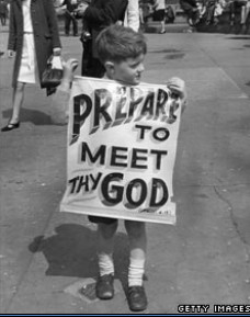 photo of child holding a sign 'PREPARE TO MEET THY GOD'