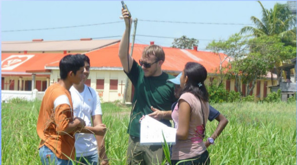 photograph of students collecting data in the field