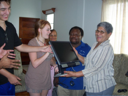 photograph of donation of computer equipment