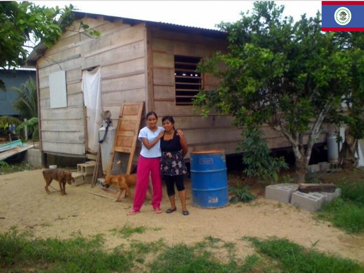 photo of student and mother in front of home