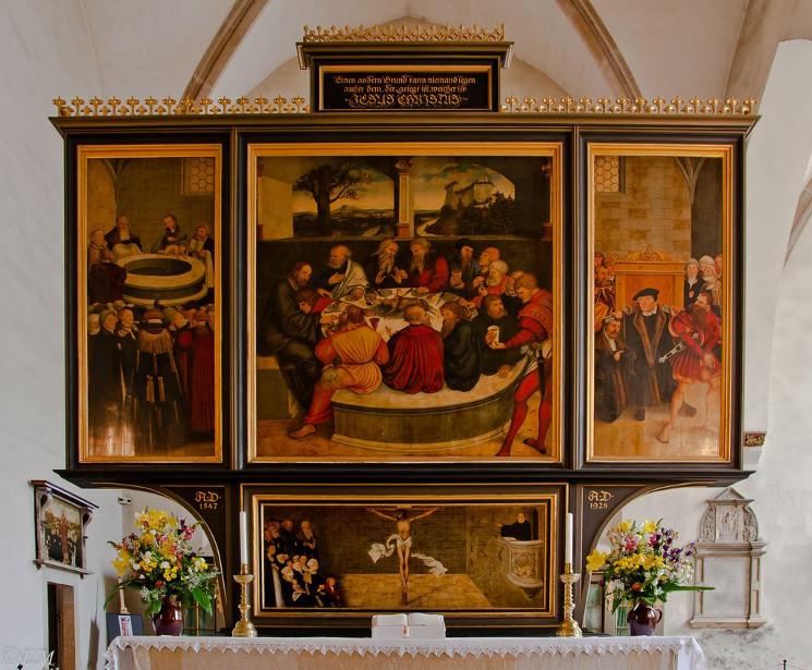 paintings behind an altar table