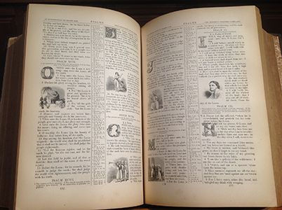 photo of open Bible with many illustrations