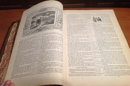 photo of open Bible with illustration