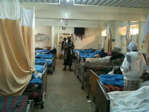 photo of a dozen beds in ward of hospital