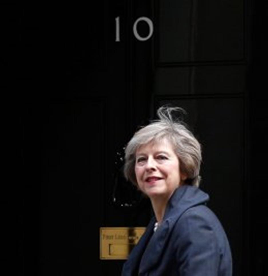 photo of Theresa May at front door of 10 Downing Street