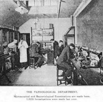 photo of workers with microscopes for pathology and bacterialogical exams