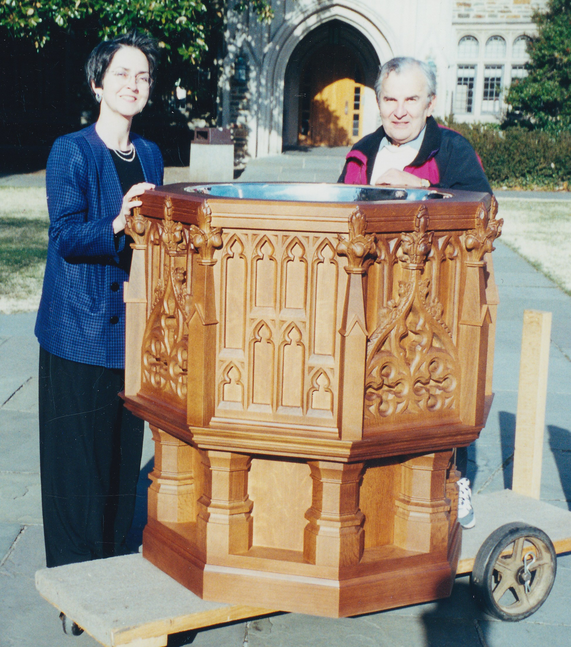photo of The Rev. Ferree-Clark with the font and Ed Karolak