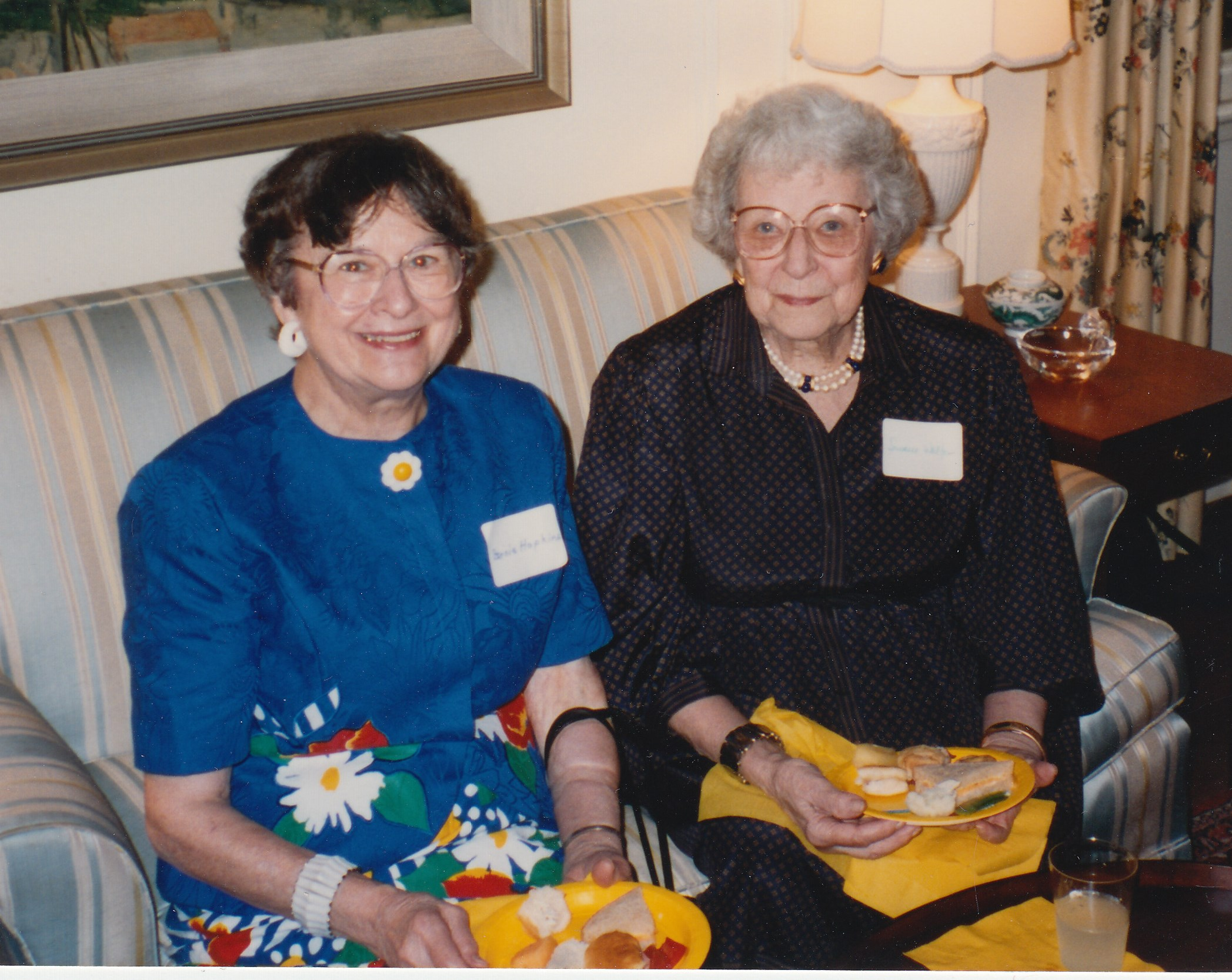 photo of two members at fellowship event with food