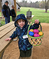 child with basket of Easter eggs