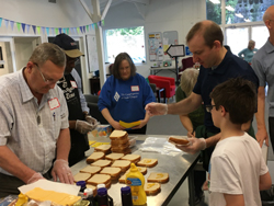 Meals on Wheels group making sandwiches