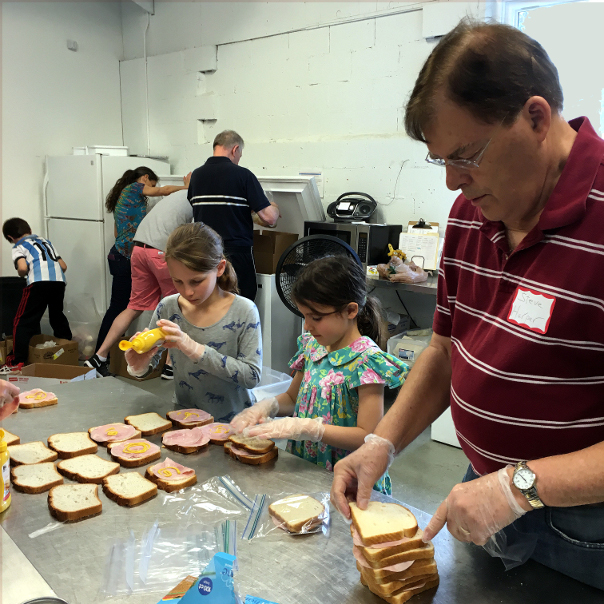 volunteers making sandwiches