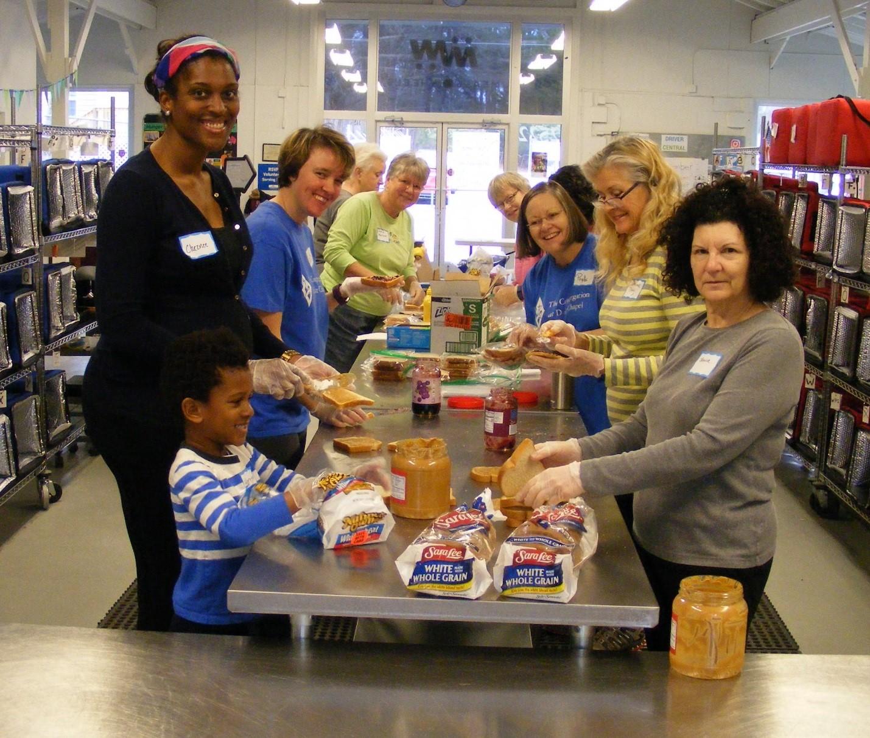 volunteers making sandwiches