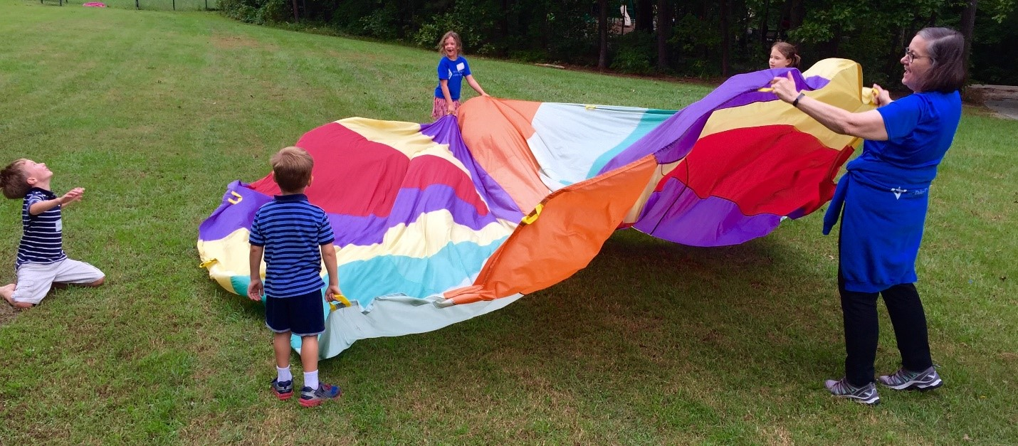 fun at a picnic with a parachute