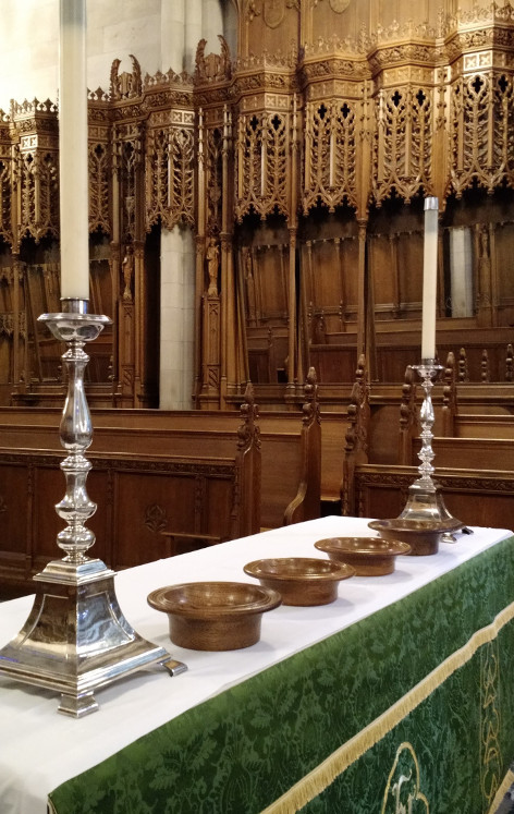 some offering plates on the altar table