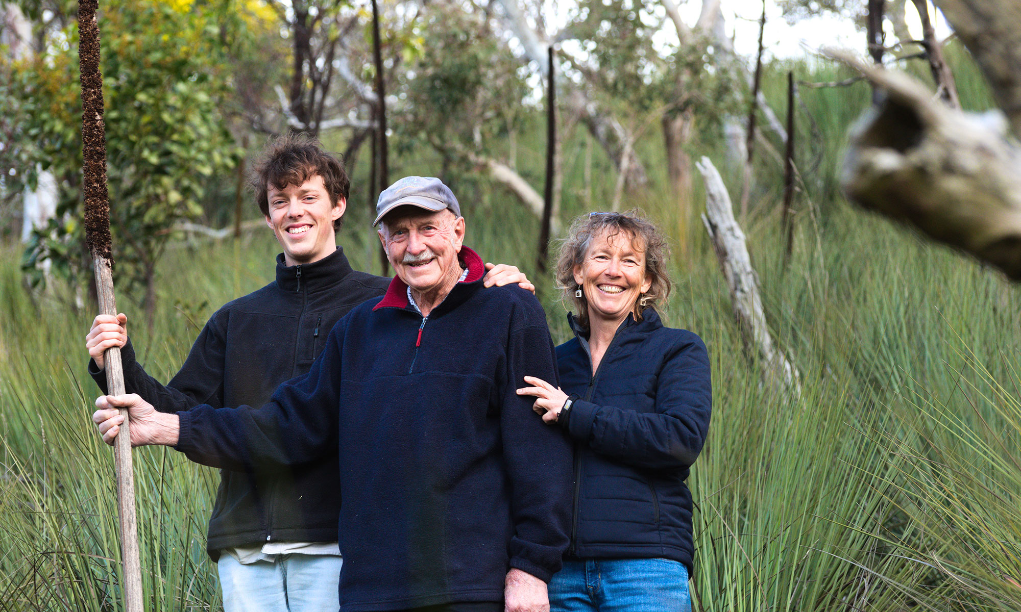 Ned, Stan and Lizzie Schofield in their native vegetation on their Paris Creek beef farm