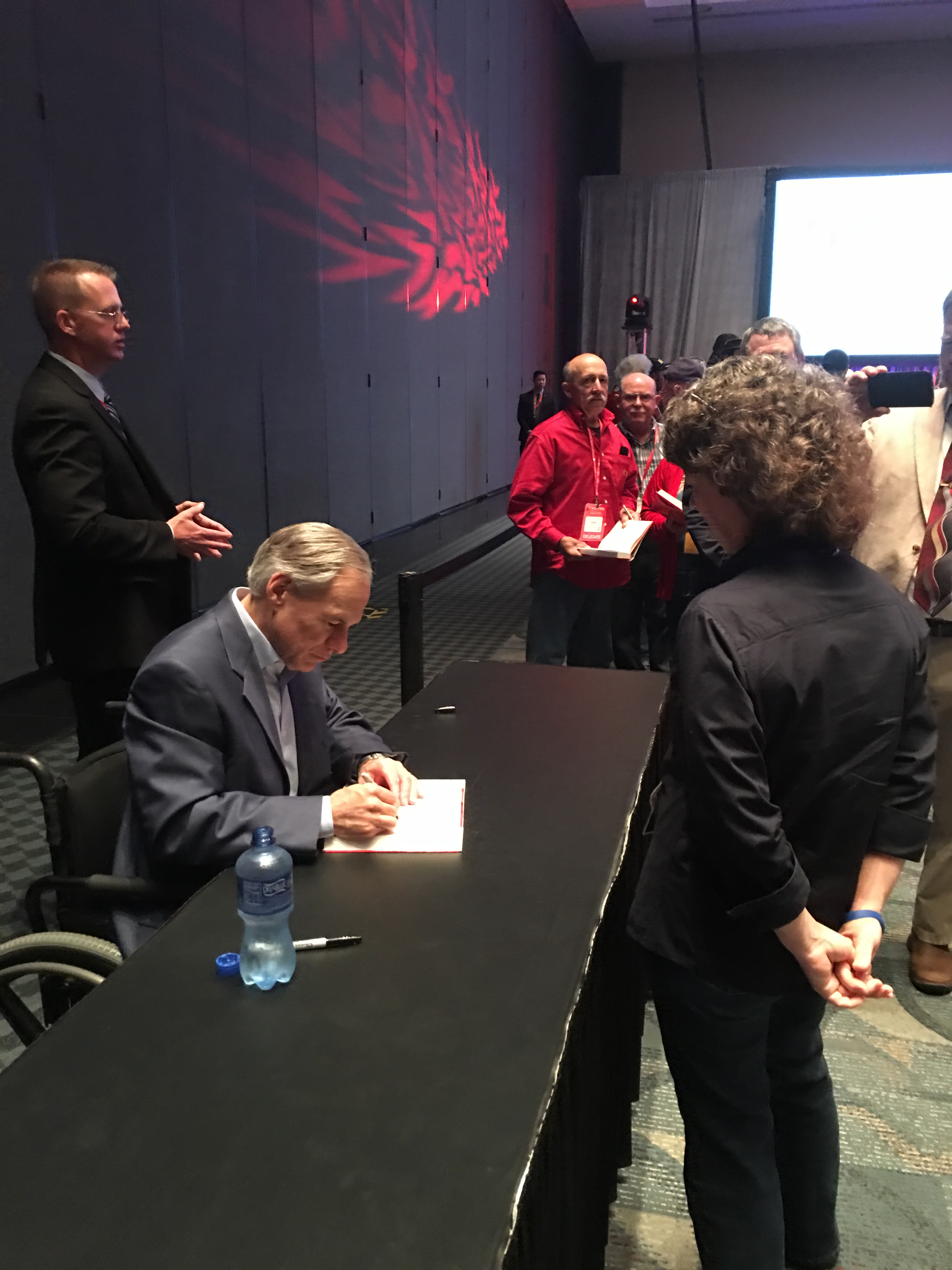 Governor_Abbott_Signs_Angie_Turner_Copy_of_Broken_But_Unbowed.JPG