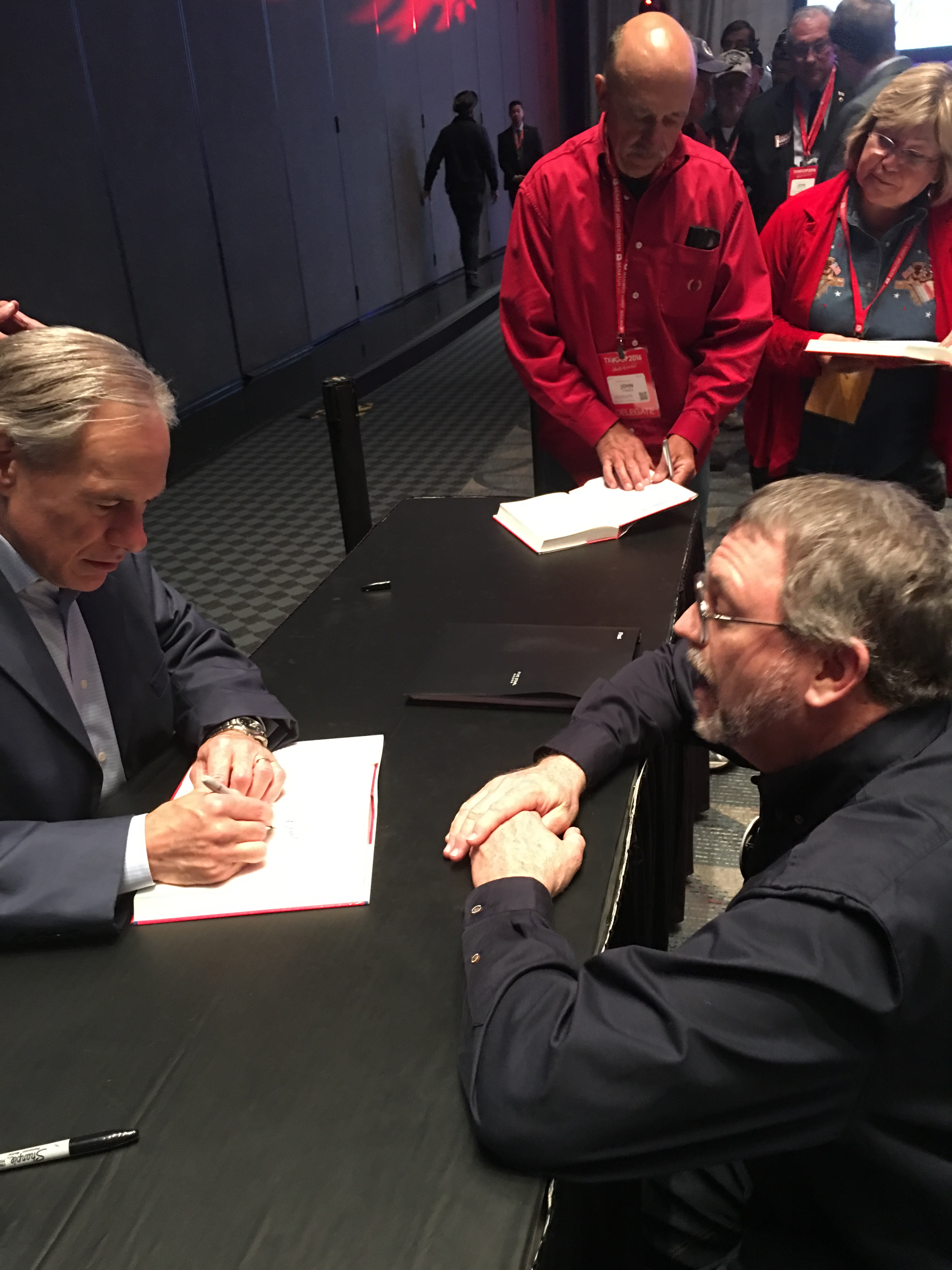 Governor_Abbott_Signs_Paul_Hodson_Copy_of_Broken_But_Unbowed.JPG